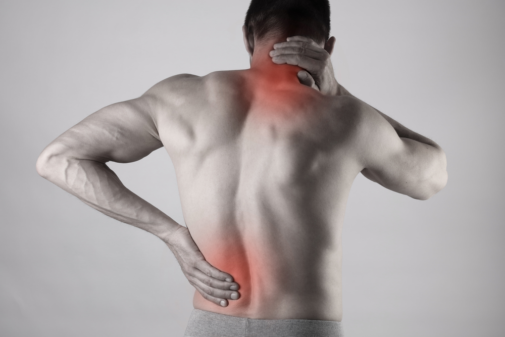 Sport injury, Man with back, neck pain. Pain relief and health care concept.